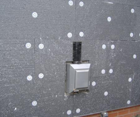 Insulation bedded in brick bond fashion with mechanical fixings
